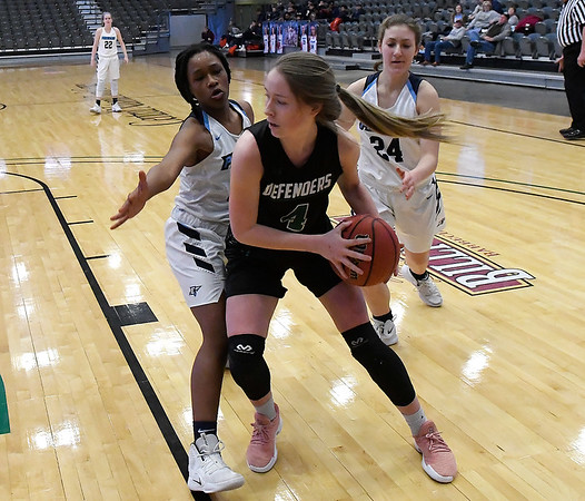 Enid's Mya Edwards and Claire Dodds pressure Green Country's Lisa Jackson during the consolation finals of the Enid Holiday Classic Saturday December 29, 2018 at the Central National Bank Center. (Billy Hefton / Enid News & Eagle)