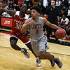 NOC Enid's Questyn Luckey drives pass NOC Tonkawa's Michael Lee Wednesday December 5, 2018 at the NOC Mabee Center. (Billy Hefton / Enid News & Eagle)