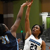 Enid's Mya Edwards shoots over Putnam City West's Akile Stone Tuesday December 11, 2018 at the Central National Bank Center. (Billy Hefton / Enid News & Eagle)
