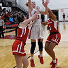 NOC Enid's Kaylee Hurst puts up a shot between NOC Tonkawa's ALexis Bishop and Tatiana Jones Wednesday December 5, 2018 at the NOC Mabee Center. (Billy Hefton / Enid News & Eagle)