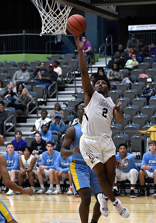 Enid's Telin Phillips gets by Putnam City West's Jaylen Rainey to score Tuesday December 11, 2018 at the Central National Bank Center. (Billy Hefton / Enid News & Eagle)