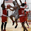 NOC Enid's Ray'Shawn Dotson goes up for a shot between NOC Tonkawa's Trevion Lamar and Deon Berrien Wednesday December 5, 2018 at the NOC Mabee Center. (Billy Hefton / Enid News & Eagle)