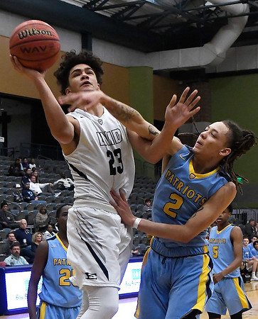 Enid's Carter Owens goes up against Putnam City West's Shelby Sampleton Tuesday December 11, 2018 at the Central National Bank Center. (Billy Hefton / Enid News & Eagle)