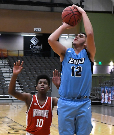 Enid's Abraham Rodriguez shoots against Hoops For Christ during the first round of the Enid Holiday Classic Thursday December 27, 2018 at the Central National Bank Center. (Billy Hefton / Enid News & Eagle)