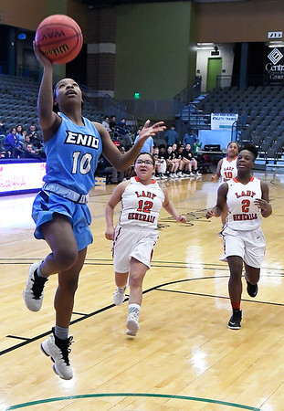 Enid's Breeasha Shaver scores a fastbreak basket against U.S. Grant during the Enid Holiday Classic Friday December 28, 2018 at the Central National Bank Center. (Billy Hefton / Enid News & Eagle)