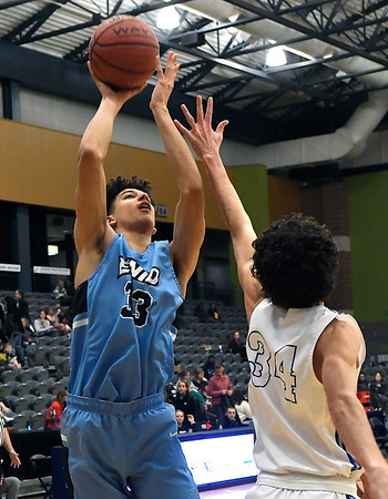 Enid's Cyson Mathis shoots over Deer Creek's Micah Sinor during the championship game of the Enid Holiday Classic Saturday December 29, 2018 at the Central National Bank Center. (Billy Hefton / Enid News & Eagle)