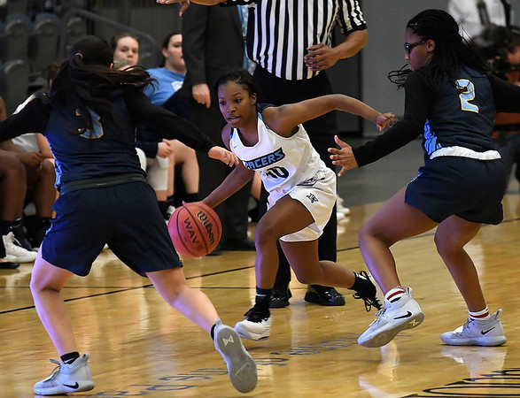 Enid's Breeasha Shaver dribbles upcourt against Putnam City West's Jocelyn Lopez and Brooklyn Fisher Tuesday December 11, 2018 at the Central National Bank Center. (Billy Hefton / Enid News & Eagle)