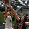 Enid's Cyson Mathis shoots over Heritage's Kyle Ingram during a semi-final of the Enid Holiday Classic Friday December 28, 2018 at the Central National Bank Center. (Billy Hefton / Enid News & Eagle)