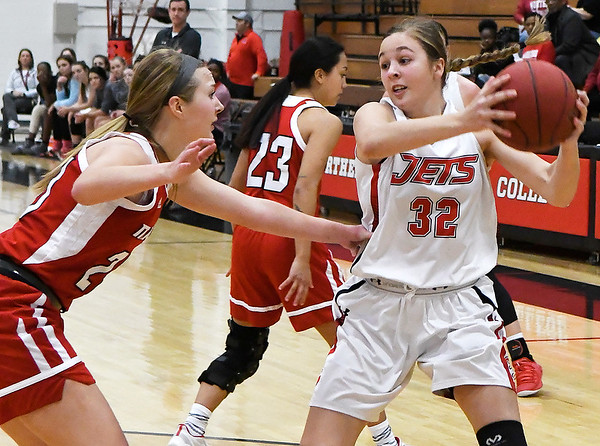 NOC Enid's Sarah Griswold looks for an opening against NOC Tonkawa's Hannah Maples Wednesday December 5, 2018 at the NOC Mabee Center. (Billy Hefton / Enid News & Eagle)