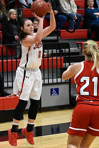 NOC Enid's Jacie Engler shoots over NOC Tonkawa's Jaiden Biddy Wednesday December 5, 2018 at the NOC Mabee Center. (Billy Hefton / Enid News & Eagle)