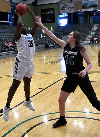 Enid's Niesha Fuston shoots over Green Country's Ashlie Maier during the consolation finals of the Enid Holiday Classic Saturday December 29, 2018 at the Central National Bank Center. (Billy Hefton / Enid News & Eagle)