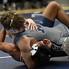 Enid's C.J. Franks wrestles Nick Sanchez of Altus Thursday, December 12, 2019 at Waller Middle School. (Billy Hefton / Enid News & Eagle)