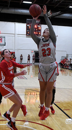 NOC Enid's Tanara Combs shoots over NOC Tonkawa's Carlee Murray Thursday, December 5, 2019 at the NOC Mabee Center. (Billy Hefton / Enid News & Eagle)