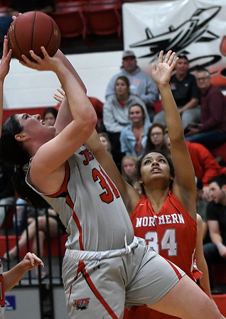 NOC Enid's Lauren Wade puts up a shot against NOC Tonkawa's Lauren Coats Thursday, December 5, 2019 at the NOC Mabee Center. (Billy Hefton / Enid News & Eagle)