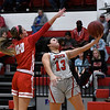 NOC Enid's Abby Phibbs goes to the basket against NOC Tonkawa's Carlee Murray Thursday, December 5, 2019 at the NOC Mabee Center. (Billy Hefton / Enid News & Eagle)