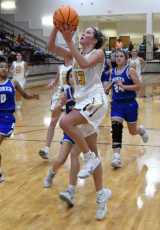 Alva's Payton Jones scores a fast break basket against Hooker during the finals of the Mustang Stampede Tournament Saturday, December 7, 2019 at Pioneer High School. (Billy Hefton / Enid News & Eagle)