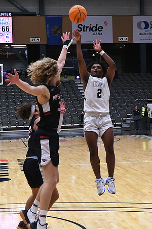 Enid's Telin Phillips hits the game winning shot over Ponca City's Luke Seals and Justin Thompson during the first round of the Enid High School Holiday Classic Thursday, December 26, 2019 at the Stride Bank Center. (Billy Hefton / Enid News & Eagle)