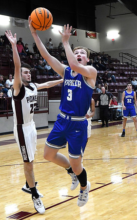 Hooker's Cole Cathcart drives to the basket pass Pioneer's Cash Hammock during the finals of the Mustang Stampede Tournament Saturday, December 7, 2019 at Pioneer High School. (Billy Hefton / Enid News & Eagle)