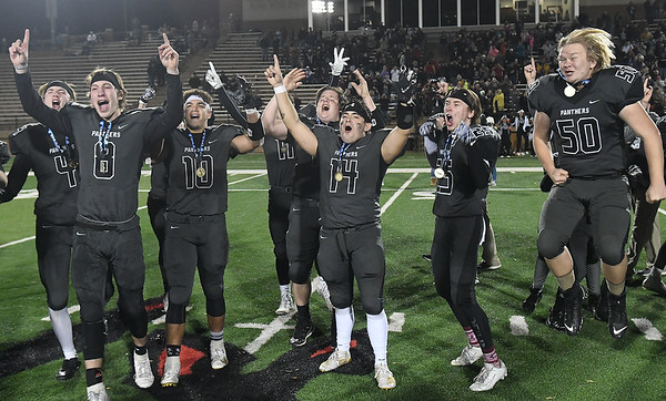 Members of the Pond Creek-Hunter football team celebrate after defeating Waynoka 54-8 to win the Class C state championship Friday, December 6, 2019 at Northwestern Oklahoma State University in Alva. (Billy Hefton / Enid News & Eagle)