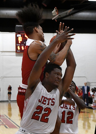 NOC Enid's Josh Perkins tussels for a rebound with NOC Tonkawa's Avante Lederer Thursday, December 5, 2019 at the NOC Mabee Center. (Billy Hefton / Enid News & Eagle)
