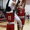 NOC Enid's Andrew O'Brien goes up for a shot between NOC Tonkawa's Tyrel Morgan and Avante Lederer Thursday, December 5, 2019 at the NOC Mabee Center. (Billy Hefton / Enid News & Eagle)