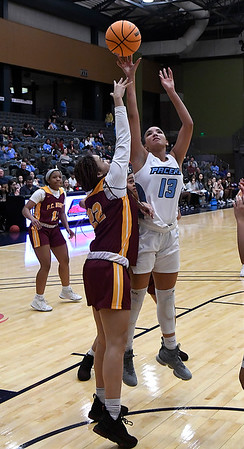 Enid's Lanie Goins shoots over Putnam City North's Amaya Chandler Tuesday, December 3, 2019 at the Stride Bank Center. (Billy Hefton / Enid News & Eagle)