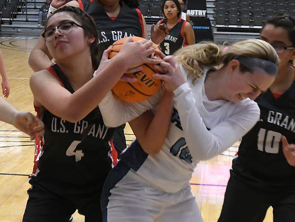 Enid's Ashlyn Manning gets ties up with U.S. Grant's Asia Grimsley during the second day of the Enid High School Holiday Classic Friday, December 27, 2019 at the Stride Bank Center. (Billy Hefton / Enid News & Eagle)