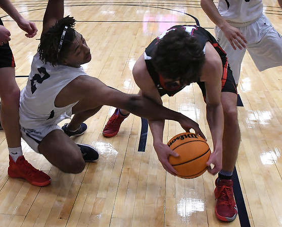 Enid's Telin Phillips tries to knock the ball away from Bixby's Connor Loney during the second day of the Enid High School Holiday Classic Friday, December 27, 2019 at the Stride Bank Center. (Billy Hefton / Enid News & Eagle)