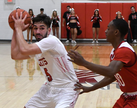 NOC Enid's Zach McDermott looks for an opening against NOC Tonkawa's Tyrel Morgan Thursday, December 5, 2019 at the NOC Mabee Center. (Billy Hefton / Enid News & Eagle)