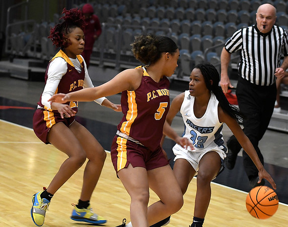 Enid's Mya Edwards is pressured by Putnam City North's Bria Sanders-Woods and Jayda Garrison Tuesday, December 3, 2019 at the Stride Bank Center. (Billy Hefton / Enid News & Eagle)