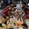 Enid's Sam Hill tries to dribble between Putnam City North's Kole Johnson and Josh Nwankwo Tuesday, December 3, 2019 at the Stride Bank Center. (Billy Hefton / Enid News & Eagle)