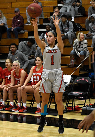 NOC Enid's Shelby Black shoots a three point shot against NOC Tonkawa Thursday, December 5, 2019 at the NOC Mabee Center. (Billy Hefton / Enid News & Eagle)