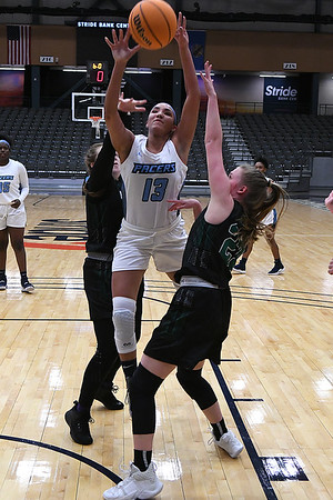 Enid's Lanie Goins puts up a shot between Green Country's Grayce Southern and Ashley Phelan during the first round of the Enid High School Holiday Classic Thursday, December 26, 2019 at the Stride Bank Center. (Billy Hefton / Enid News & Eagle)