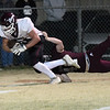 Pioneer's Dakota Wingo drags Velma Alma's Austin Hunt across the goaline for a touchdown in the class B state quarter finals Friday, December 4, 2020 at Velma-ALma High School. (Billy Hefton / Enid News & Eagle)