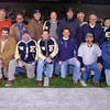Players and coaches of the Enid High School 1983 state championship team at halftime Friday at D. Bruce Selby Stadium. (Staff Photo by BILLY HEFTON)