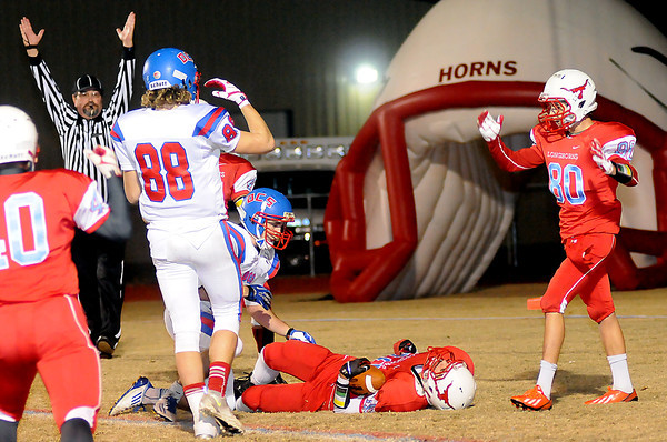The referee signals a Longhorn touchdown late in the 4th quarter as Chisholm's Anthony Vallejo scores against Oklahoma Christian School during the OSSAA 2A football playoffs Friday, Nov. 15, 2013. (Staff Photo by BONNIE VCULEK)