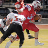 Chisholm's Bryce Stewart breaks away from two Tonkawa defenders for the Longhorn's first touchdown against the Buccaneers Friday, Nov. 8, 2013. (Staff Photo by BONNIE VCULEK)