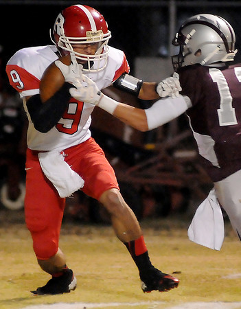 Ringwood's Rolando Resendiz fights for extra yards against Garber's Dallas Hunt during the Wolverines' 28-18 win over the Red Devils Friday, Nov. 1, 2013. (Staff Photo by BONNIE VCULEK)