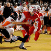 Chisholm's Karsten Brady eludes Tonkawa's Kevin Howard during the Longhorns' win over the Buccaneers Friday, Nov. 8 2013. (Staff Photo by BONNIE VCULEK)