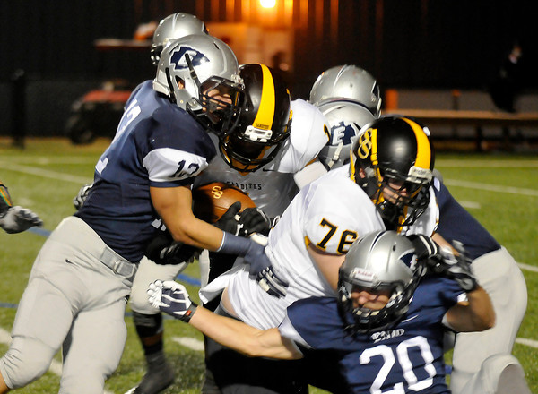 Enid's Christian Voitik stops Tre Betts of Sand Springs Friday at D. Bruce Selby Stadium. (Staff Photo by BILLY HEFTON)