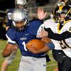 Trace Fleischman of Sand Springs grabs Enid quarterback, Freddie Lawrence, during the fourth quarter Friday at D. Bruce Selby Stadium. (Staff Photo by BILLY HEFTON)