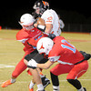 Chisholm's Colton Johnson (80) and Bailey Cross (12) sandwich Tonkawa's Owen Simpson (22) during the Longhorns' 33-8 win at Chisholm Friday, Nov. 8, 2013. The Chisholm Longhorns finish the season 9-1. (Staff Photo by BONNIE VCULEK)