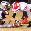 Garber's Alec Monsees (24) and Ringwood's Triston Morris (7) collide as they battle for the loose pigsking after the Red Devils' center hiked the ball over Morris' head during the Wolverines' 28-18 win at Warren Dell Stadium Friday, Nov. 1, 2013. (Staff Photo by BONNIE VCULEK)