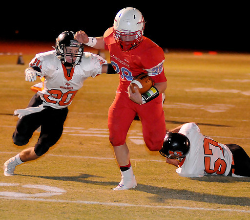 Chisholm's Bryce Stewart sprints into the end zone for a Longhorn touchdown as Tonkawa's Colton Esch (20) and Jacob Collins (57) defend for the Buccaneers Friday, Nov. 8, 2013. Chisholm finishes the season 9-1 with the 33-8 win over Tonkawa at Longhorn Field. (Staff Photo by BONNIE VCULEK)