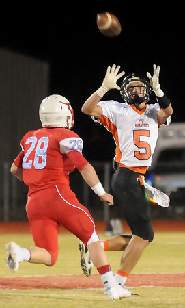 Tonkawa's Nick Franklin turns for a catch as Chisholm's Bryce Stewart defends during the Longhorns' win over the Buccaneers Friday, Nov. 8, 2013. (Staff Photo by BONNIE VCULEK)