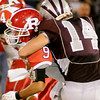 Garber's Tyler Hatch (right) wraps up Ringwood's Rolando Resendiz behind the line of scrimmage during the Wolverines' 28-18 win Friday, Nov. 1, 2013. (Staff Photo by BONNIE VCULEK)