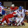 Chisholm's Karsten Brady (10) tackles OCS Saints' quarterback, Thomas Qualls, for a loss during the OSSAA Class 2A football playoffs at Longhorn Community Stadium Friday, Nov. 15, 2013. (Staff Photo by BONNIE VCULEK)