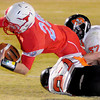 Chisholm's Bryce Stewart dives for the goal line as Tonkawa's Chase Pfluger (27) and Jacob Collins (57) stop the touchdown threat during the Longhorns' win at Chisholm Friday, Nov. 8, 2013. (Staff Photo by BONNIE VCULEK)