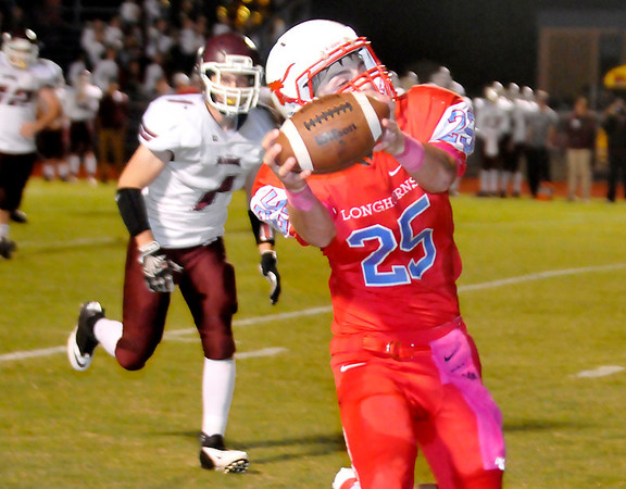 Chisholm's Britton Yunker grabs a pass late in the first half against Perry Thursday. (Staff Photo by BILLY HEFTON)
