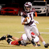 Garber's Dallas Hunt escapes a Ringwood tackle at Warren Dell Stadium in Garber Friday, Nov. 1, 2013. The Wolverines defeated the Red Devils 28-18. (Staff Photo by BONNIE VCULEK)